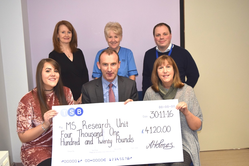 Photo of cheque presentation to MS research department