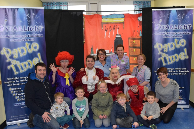 Staff and patients with cast of Dick Whittington