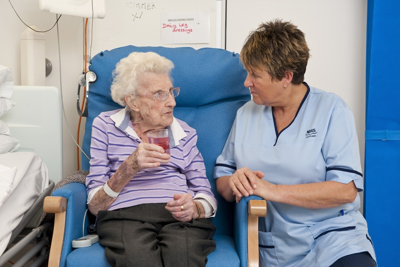 elderly lady talking to a nurse