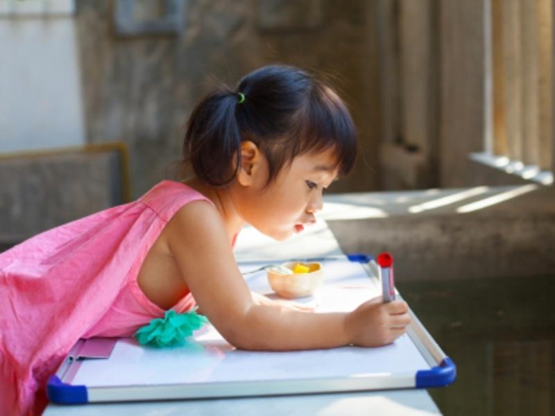 Child Writing on Whiteboard